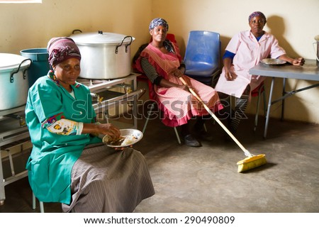 HOEDSPRUIT, SOUTH AFRICA - APRIL 17: Cooks from a school in a small township near Kruger park at rest after lunch, on April 17, 2015 in Hoedspruit, South Africa