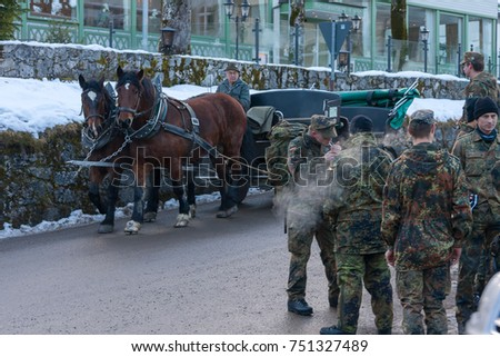 HOHENSCHWANGAU/ GERMANY - DECEMBER 16, 2008: Military group stand on winter street during smoke break against cab background on December 16, 2008 in Hohenschwangau.  #751327489