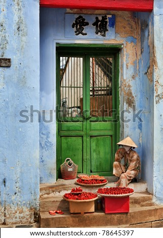 Hoi An Street Vendor, Vietnam, selling red chillis