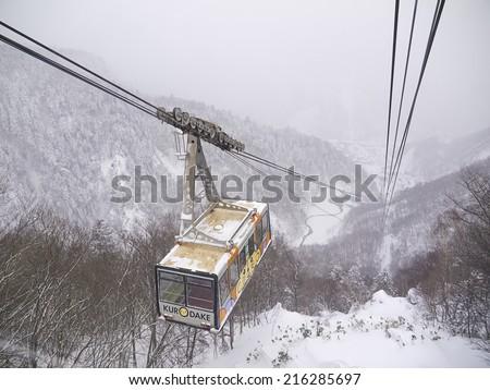 HOKKAIDO, JAPAN - DEC 16: Kurodake ropeway car ascending to the 5th Station halfway up to the summit of Mount Kurodake that towers over Sounkyo Onsen on Dec 16, 2011 in Central Hokkaido, Japan..