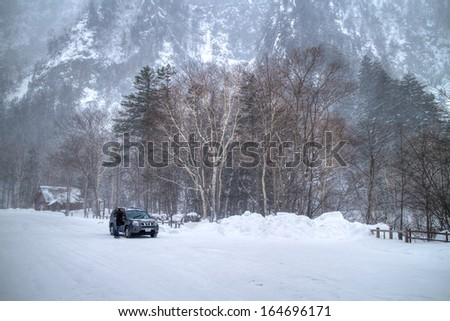 Hokkaido, Japan-Feb.2: A car was in a big snowstorm at snow mountain area. The temperature was -10 deg.C and the car was hardly to be driven. Feb.2 in Hokkaido, Japan.