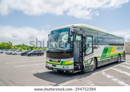 HOKKAIDO, JAPAN - JUNE 19, 2015 : Long distance bus at the car park of gas station on June 19, 2015 in Hokkaido, Japan.