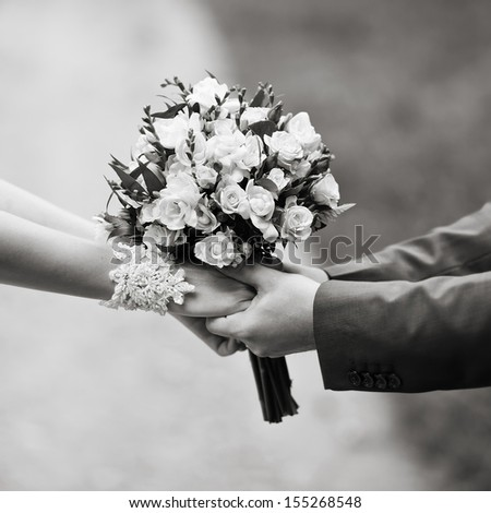 hold me, marry me, hands of a wedding  couple in black and white