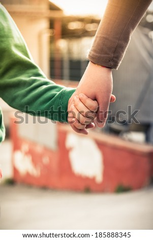 Hold my hand - Mother and son holding hands