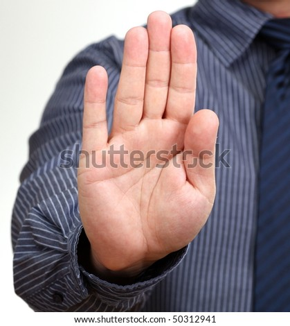 Hold on, Stop gesture showed by businessman hand