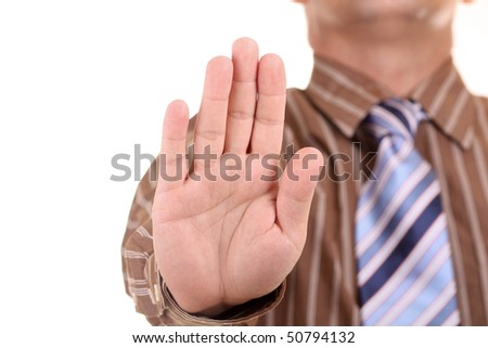 Hold on, Stop gesture showed by businessman hand.