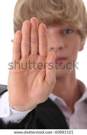 Hold on, Stop gesture showed by businessman hand - stock photo