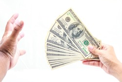 Hold one hundred dollars in hand on white background.
