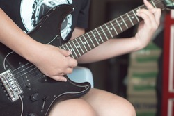 Hold playing the electric guitar black by women