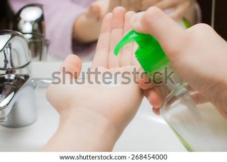 holding a bottle sanitizer
