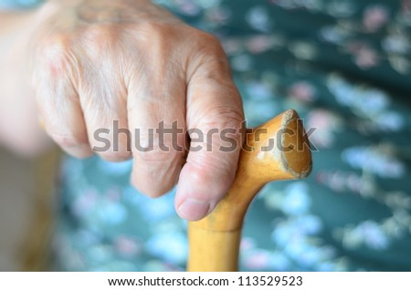holding a cane