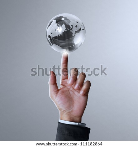 holding a glowing earth globe and hand