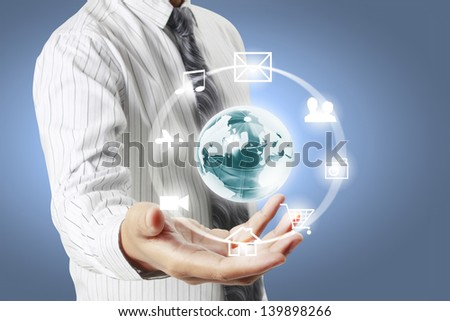 holding a glowing earth globe in his hands