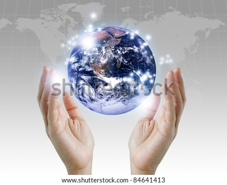 holding a glowing earth globe in his hands. Earth image provided by Nasa.