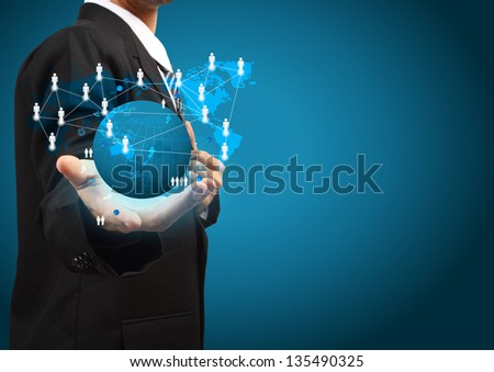 Holding a glowing earth globe social network in the hands of businessmen