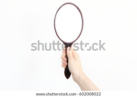 Holding a hand mirror #602008022