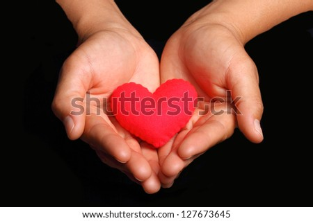 Holding a Heart #127673645