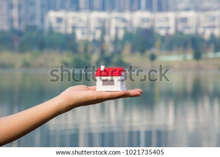 Holding a House Model / Concept River View Room - Shutterstock ID 1021735405