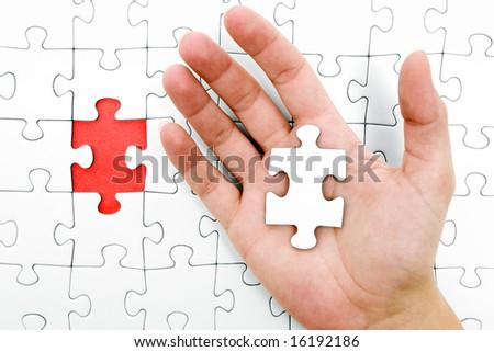 Holding a Jigsaw Piece