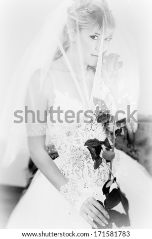 holding a red rose. bride and wedding concept - young woman with rose flower