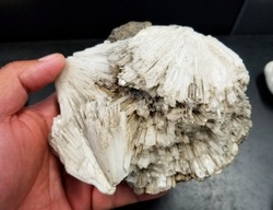 Holding a Scolecite, a common Icelandic mineral formed by volcanic eruptions