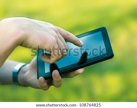 holding and touching on digital tablet pc - stock photo
