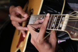 Holding chords to play guitar
