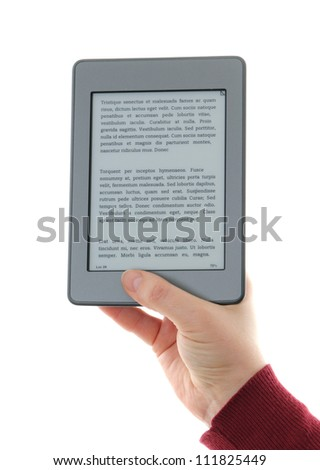 Holding E-book reader in hands,   The reader is deprived of all brand names and buttons, includes a sample text: Lorem Ipsum, which is the text used as an example of a filler in the printing industry.
