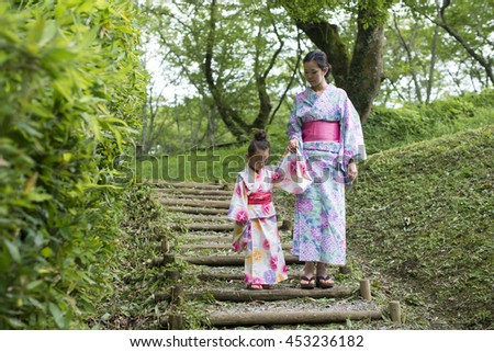 Holding Hands mother and daughter wearing yukata #453236182