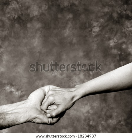Holding hands on a grey background