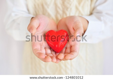 Holding heart in hands #124801012