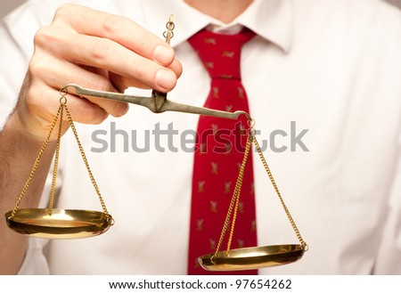 holding justice scale - stock photo