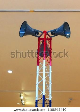 Holding megaphone.Horn speaker for public relations sign symbol #1108911410