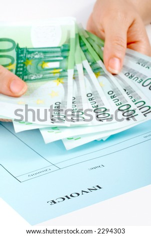 Holding money over the blank invoice. Focus in front and small DOF