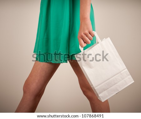Holding paper bags. Consumerism symbol.