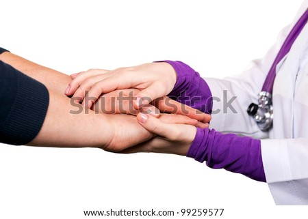 Holding patient`s hand, giving help - stock photo
