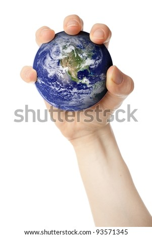 Holding planet Earth in fist. Earth globe image provided by NASA.