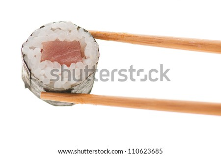 Holding Roll With Chopsticks On White Background
