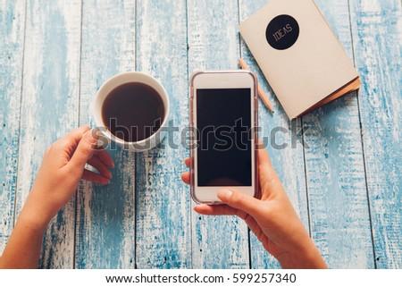 Holding smartphone #599257340