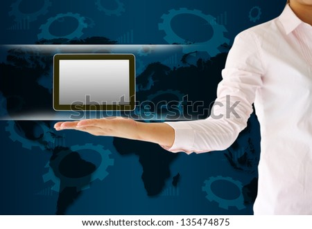 holding tablet computer in his hand