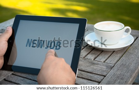 Holding tablet pc - stock photo