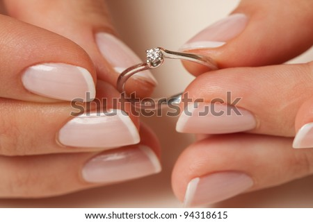 Holding the engagement ring