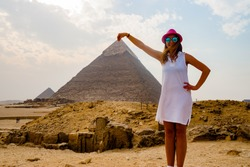 Holding the pyramid in Cairo, Egypt