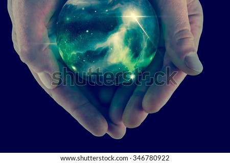 Holding the universe in fortune teller magic crystal ball #346780922