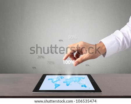 holding touch screen tablet and graphs in hand