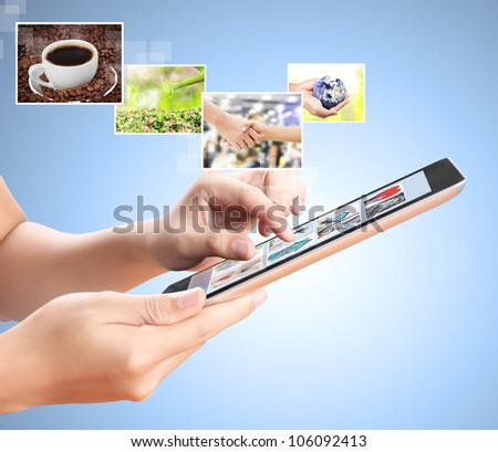 holding touch screen tablet with streaming images