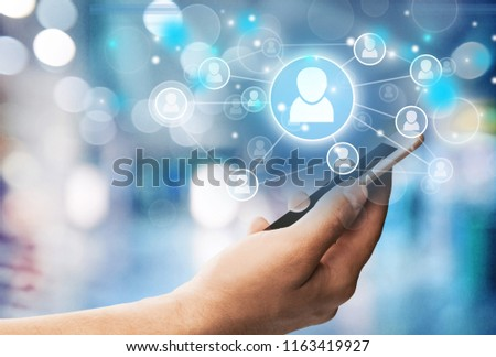 Holding Touchscreen Device #1163419927