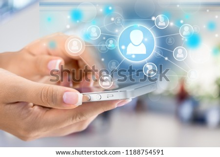Holding Touchscreen Device #1188754591