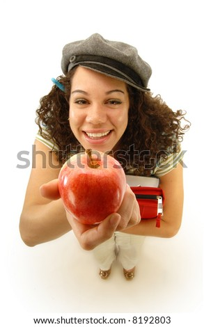 Holding up a classic bribe for an unsuspecting teacher; focus on the apple