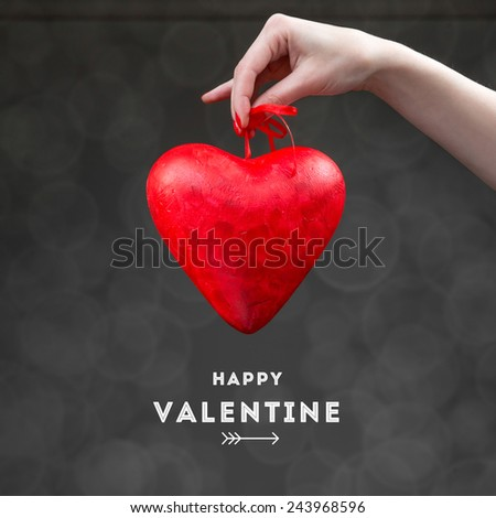 Holding Valentine heart box on the dark background. Greeting card concept